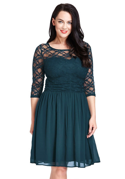 Brunnette model in peacock lace crop-sleeves skater dress
