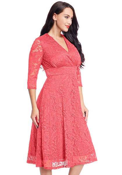 Right side view of model in plus size coral surplice midi dress