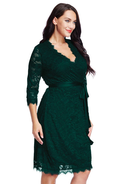 Right side view of model in plus size deep green lace crop sleeves wrap dress