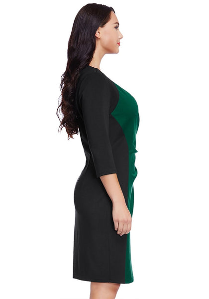 Right side view of model in plus size green raglan sleeve dress