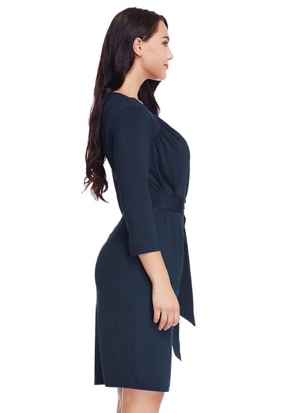 Right side view of model in plus size navy sweetheart wrap midi dress