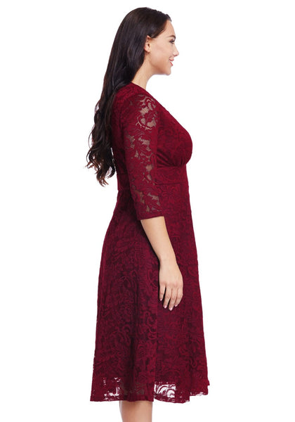 Right side view of model in plus size red lace surplice midi dress