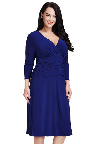 Right side view of model in plus size royal blue ruched waist dress