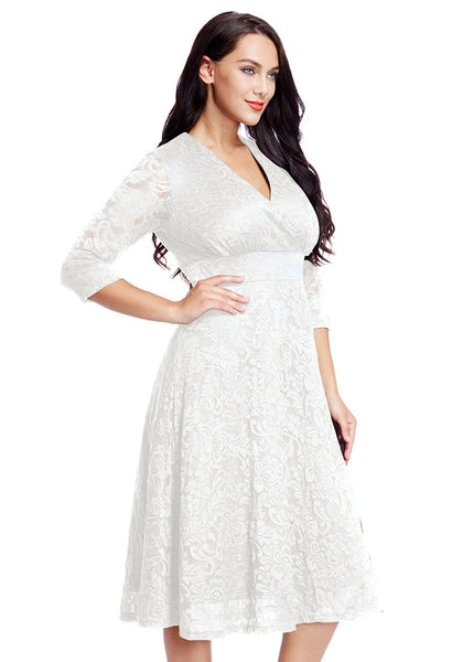 Right side view of model in plus size white lace surplice midi dress