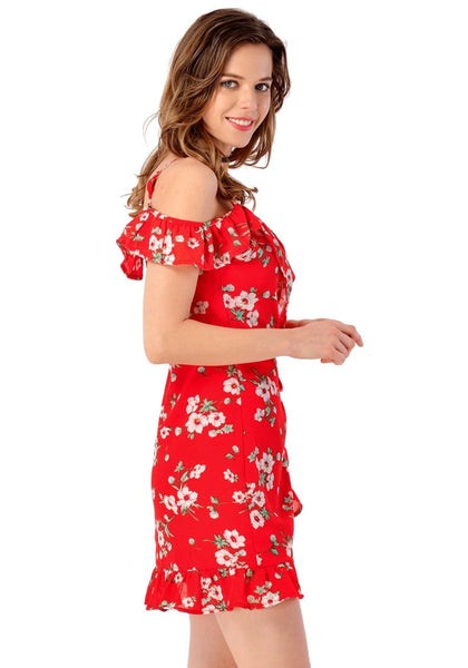Right side view of model in red floral ruffled cold-shoulder wrap dress