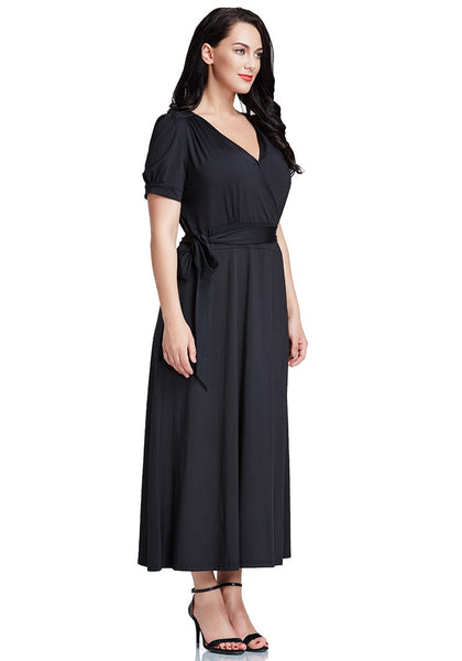 Right side view of model inplus size black surplice belted long dress