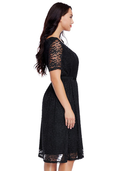 Right side view of model wearing plus size black lace midi dress