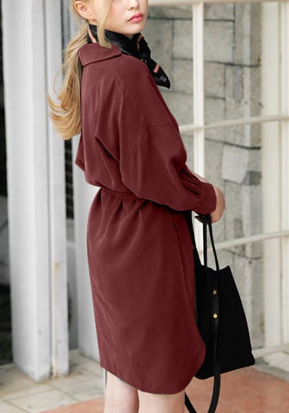 Right side view of woman in burgundy tie belt shirt dress