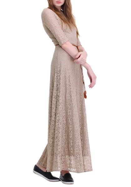 Right side view of woman posing in a khaki maxi lace dress