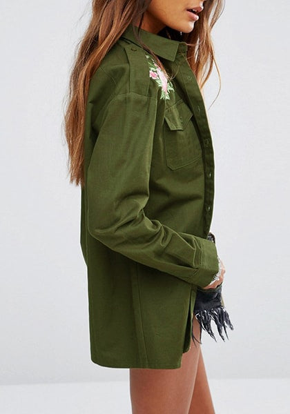 Right side view woman wearing army green floral-embroidered shoulder shirt
