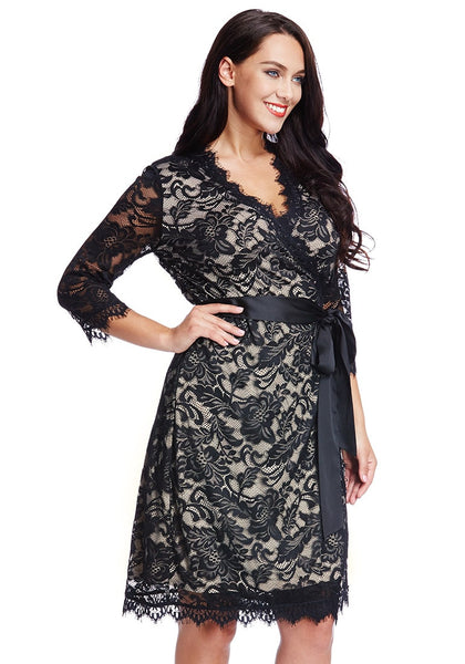 Right sied view of model in plus size neutral lace crop sleeves wrap dress