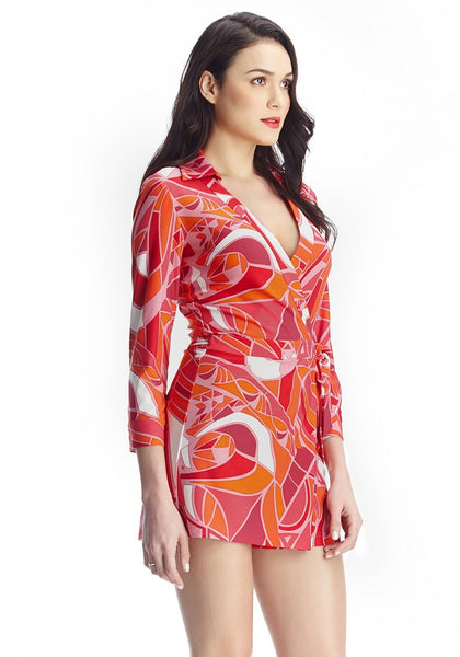 Right view of model in abstract wrap-style long sleeves romper