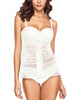 Front view of model in white split-front hollow lace tankini set
