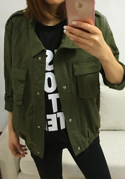 Sexy model in moss green button-down military jacket and selfie