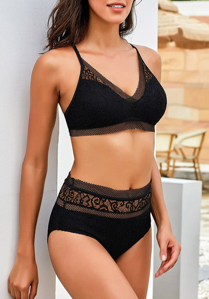 Sexy model wearing black fishnet-trim high waist lace bikini set