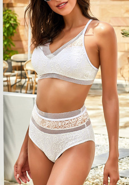 Sexy model wearing white fishnet-trim high waist lace bikini set