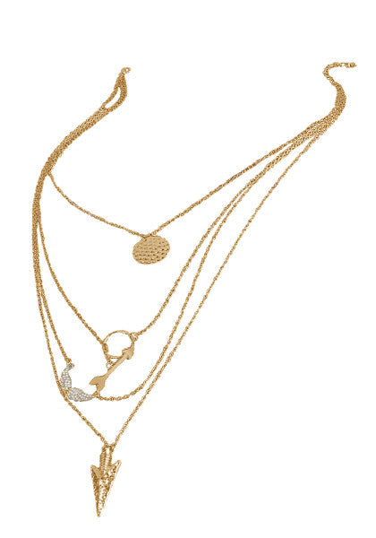 Shot of four-chain gold necklace