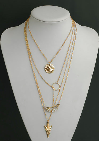 Shot of four-chain gold necklace on mannequin