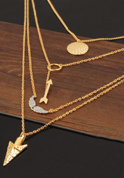 Shot of four-chain gold necklace on table