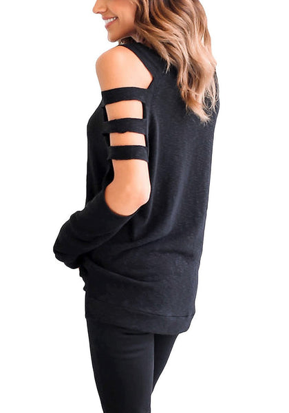 Side angle shot of woman in black cold-shoulder hollow-out blouse