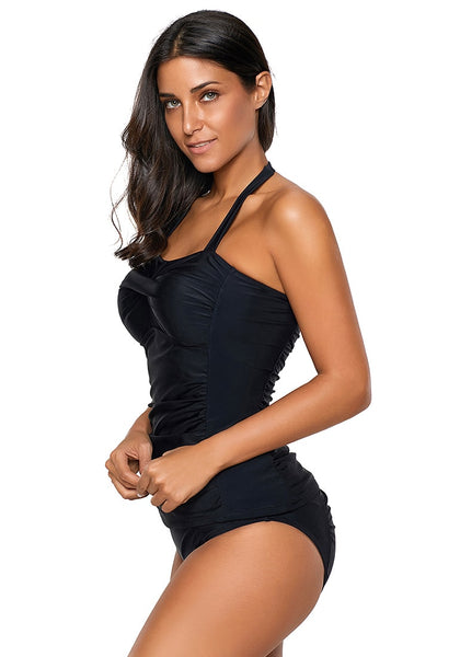 Side shot of model in black sweetheart neckline halter ruched tankini set