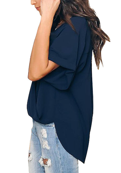 Side shot of model wearing navy V-neckline cuffed sleeves loose wrap blouse