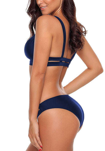 Side view od model wearing navy strappy triangle bikini set
