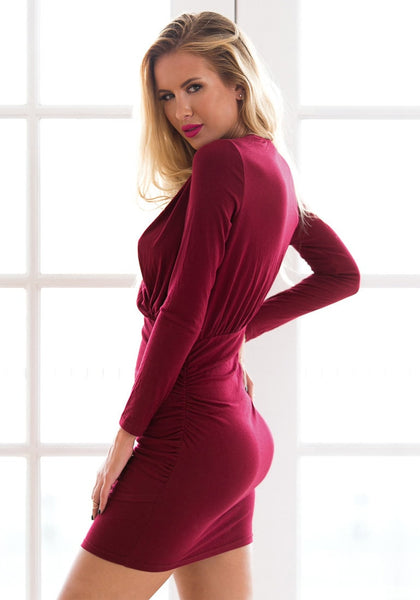 Side view of falu red ruched wrap-style dress
