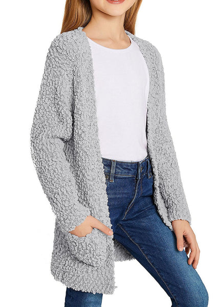 Side view of little girl in grey fuzzy fleece open-front girls cardigan