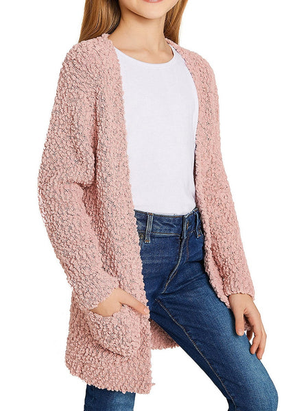 Side view of little girl in mauve pink fuzzy fleece open-front girls cardigan