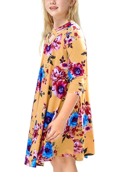 Side view of little girl wearing yellow crisscross-front crop sleeves loose floral girl dress