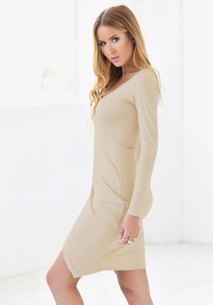 Side view of model in apricot draped wrap dress