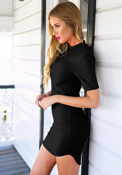 Side view of model in black curved-hem bodycon dress