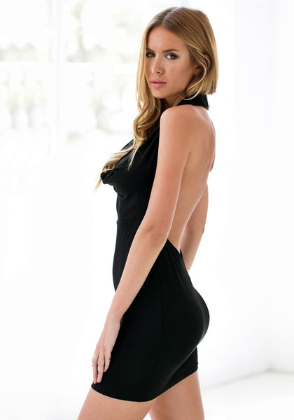 Side view of model in black one-shoulder bodycon dress