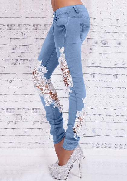 Side view of model in blue lace-paneled skinny jeans