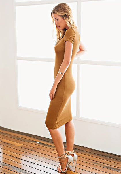 Side view of model in brown midi sheath dress