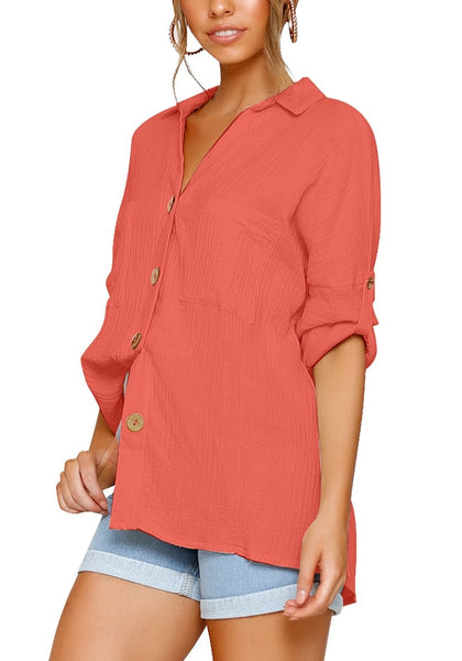 Side view of model in coral collared V-neckline cuffed sleeves button-up top