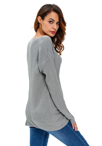 Side view of model in grey knitted plunge sweater