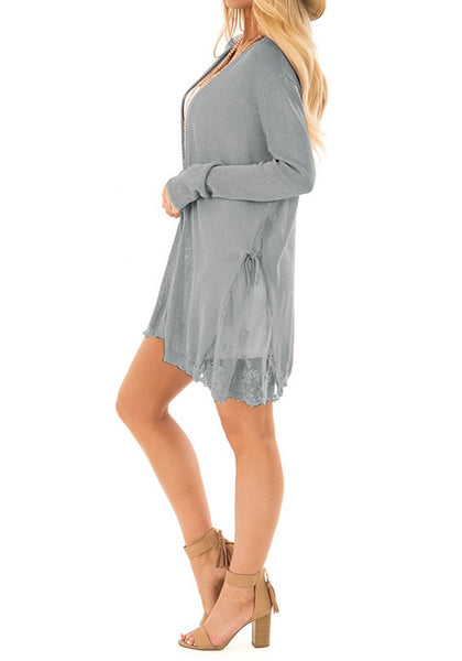 Side view of model in grey long sleeves crochet lace open-front cardigan