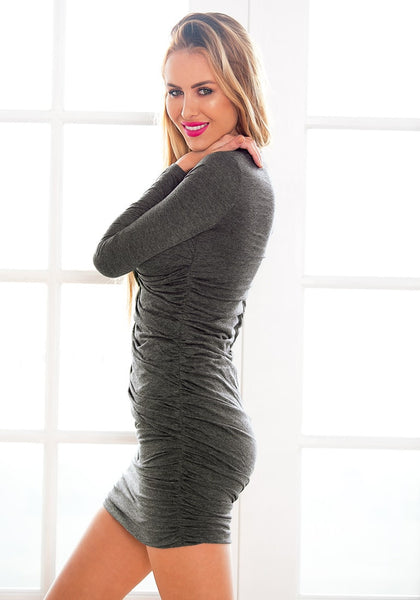Side view of  model in grey surplice ruched bodycon dress