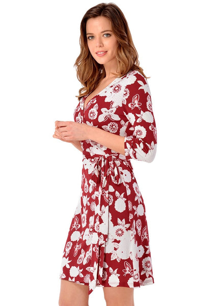 Side view of model in maroon floral plunge wrap dress