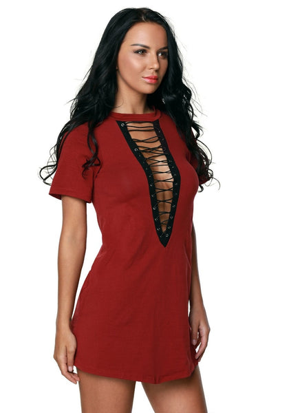 Side view of model in maroon lace up tee dress