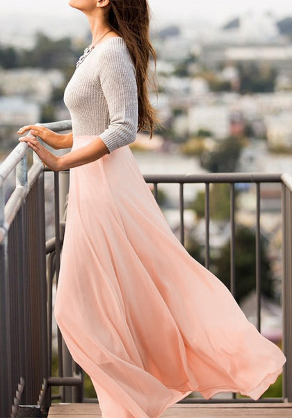 Side view of model in pink chiffon maxi skirt