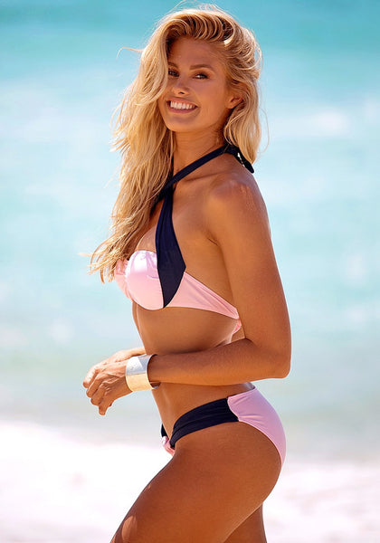 Side view of model in pink & navy bandeau bikini set