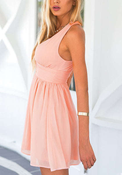 Side view of model in pink plunge halter skater dress