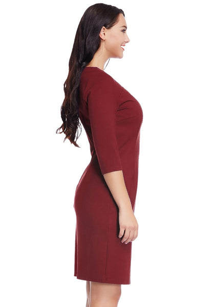 Side view of model in plus size burgundy decollete neckline pencil dress