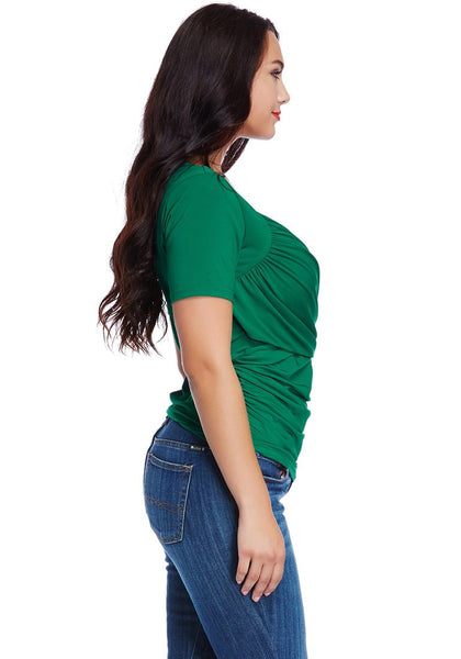Side view of model in plus size green ruched surplice top