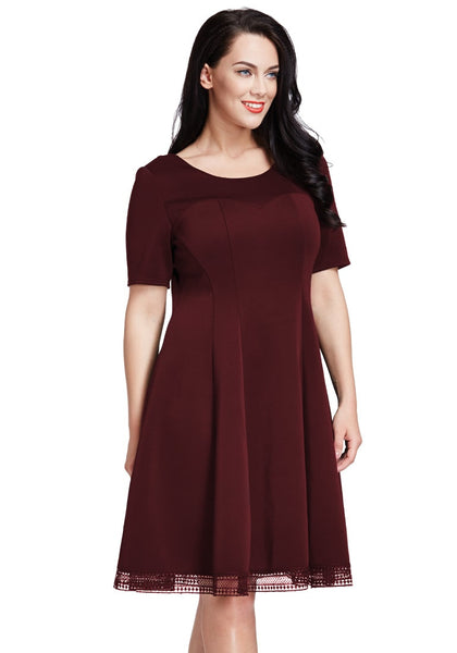 Side view of model in plus size port short-sleeves skater dress