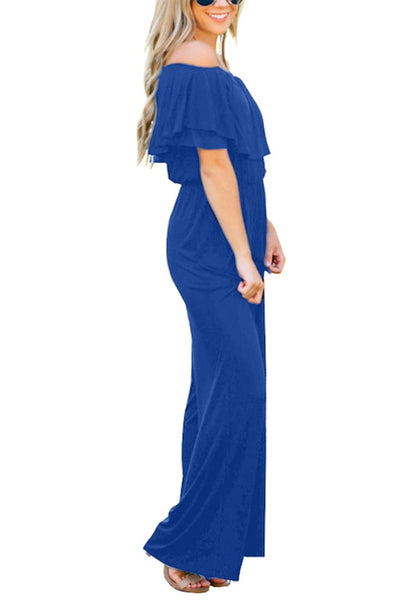 Side view of model in royal blue ruffled off-shoulder jumpsuit