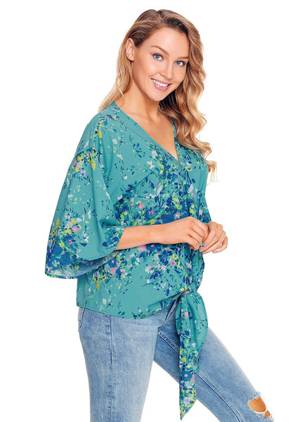 Side view of model in sky blue floral print tie front chiffon blouse